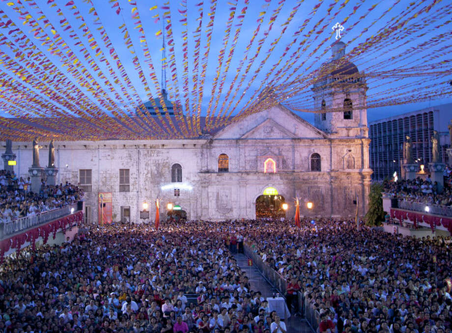 FILE- This is a January 2011 file photo of the facade of Basilica de Sto. Nino (Basilica of the Holy Child) with its towering bell tower in Cebu city in central Philippines. On Tuesday Oct. 15, 2013 a 7.2-magnitude earthquake struck Cebu city toppling the bell tower of the Philippines' oldest church and sending terrified residents into deadly stampedes. (AP Photo/Chester Baldicantos, File) / STR