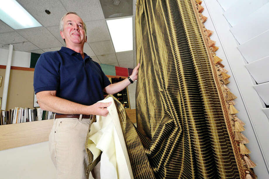 Hour photo / Erik Trautmann Fullam's owner, Peter Fullam in the window treatment shop his father bought in 1969. / (C)2013, The Hour Newspapers, all rights reserved