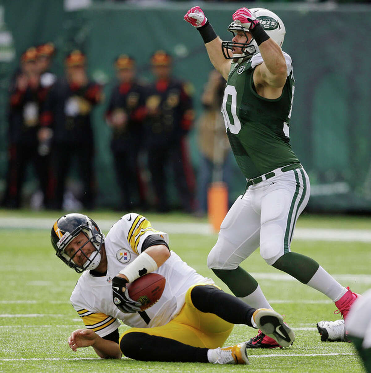 New York Jets outside linebacker Garrett McIntyre (50) reacts after sacking Pittsburgh Steelers quarterback Ben Roethlisberger (7) during the first half of an NFL football game Sunday, Oct. 13, 2013, in East Rutherford, N.J. (AP Photo/Seth Wenig)