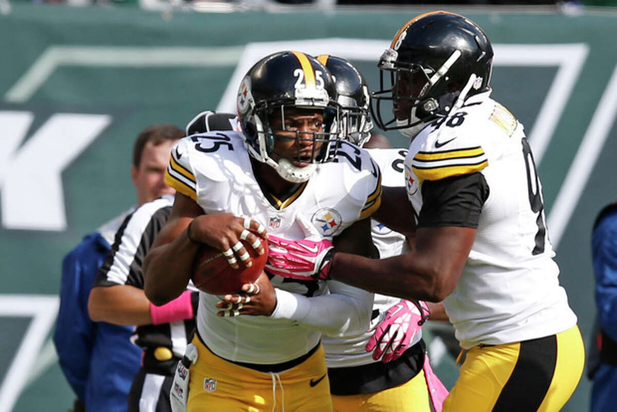 Pittsburgh Steelers free safety Ryan Clark (25) celebrates with teammates after intercepting a pass by New York Jets' Geno Smith during the second half of an NFL football game on Sunday, Oct. 13, 2013, in East Rutherford, N.J. (AP Photo/Kathy Willens)