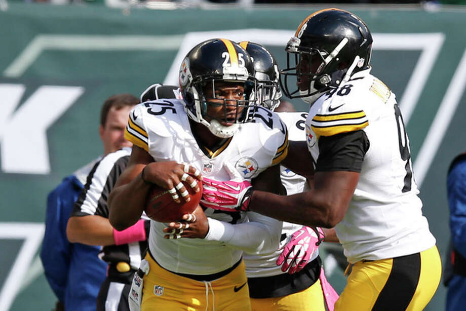 Pittsburgh Steelers free safety Ryan Clark (25) celebrates with teammates after intercepting a pass by New York Jets' Geno Smith during the second half of an NFL football game on Sunday, Oct. 13, 2013, in East Rutherford, N.J. (AP Photo/Kathy Willens) / AP