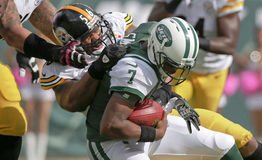 Pittsburgh Steelers outside linebacker LaMarr Woodley (56) sacks New York Jets quarterback Geno Smith (7) during the first half of an NFL football game Sunday, Oct. 13, 2013, in East Rutherford, N.J. (AP Photo/Kathy Willens) / AP