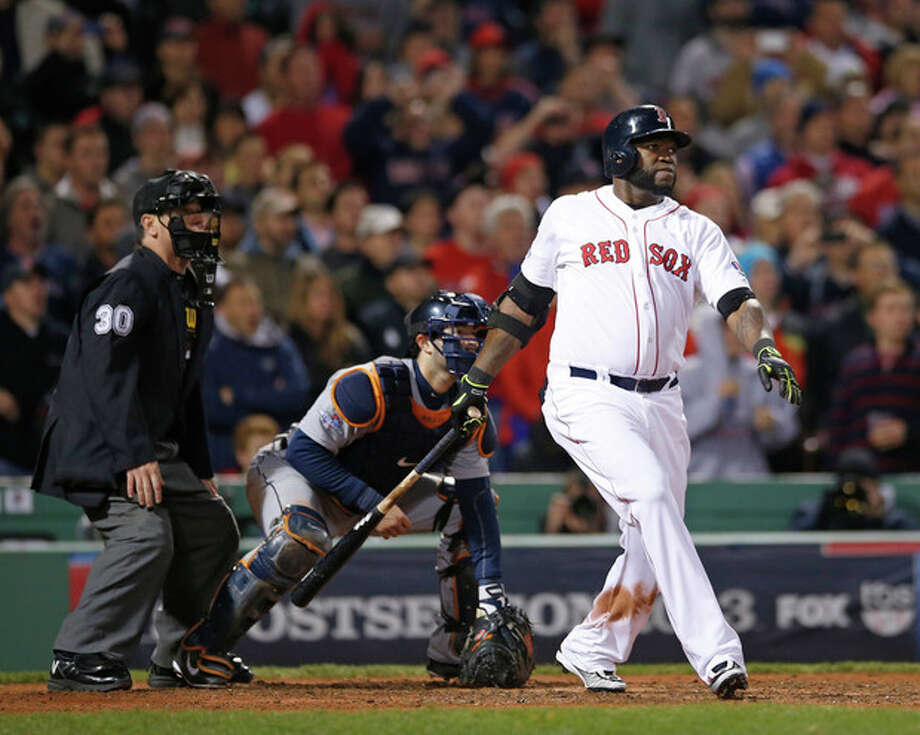 Boston Red Sox's David Ortiz hits a grand slam home run in the eighth inning during Game 2 of the American League baseball championship series against the Detroit Tigers Sunday, Oct. 13, 2013, in Boston. (AP Photo/Elise Amendola) / AP