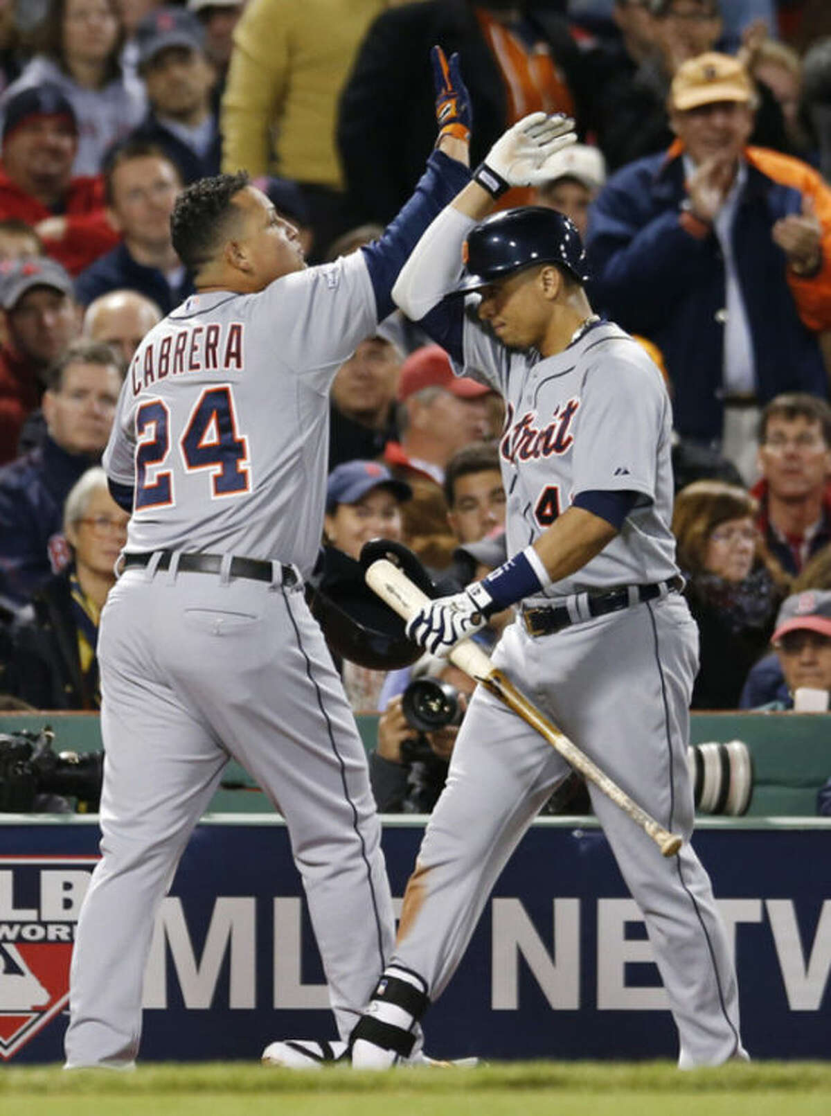 Detroit Tigers' Miguel Cabrera celebrates with Victor Martinez after hitting a home run in the sixth inning during Game 2 of the American League baseball championship series against the Boston Red Sox Sunday, Oct. 13, 2013, in Boston. (AP Photo/Elise Amendola)