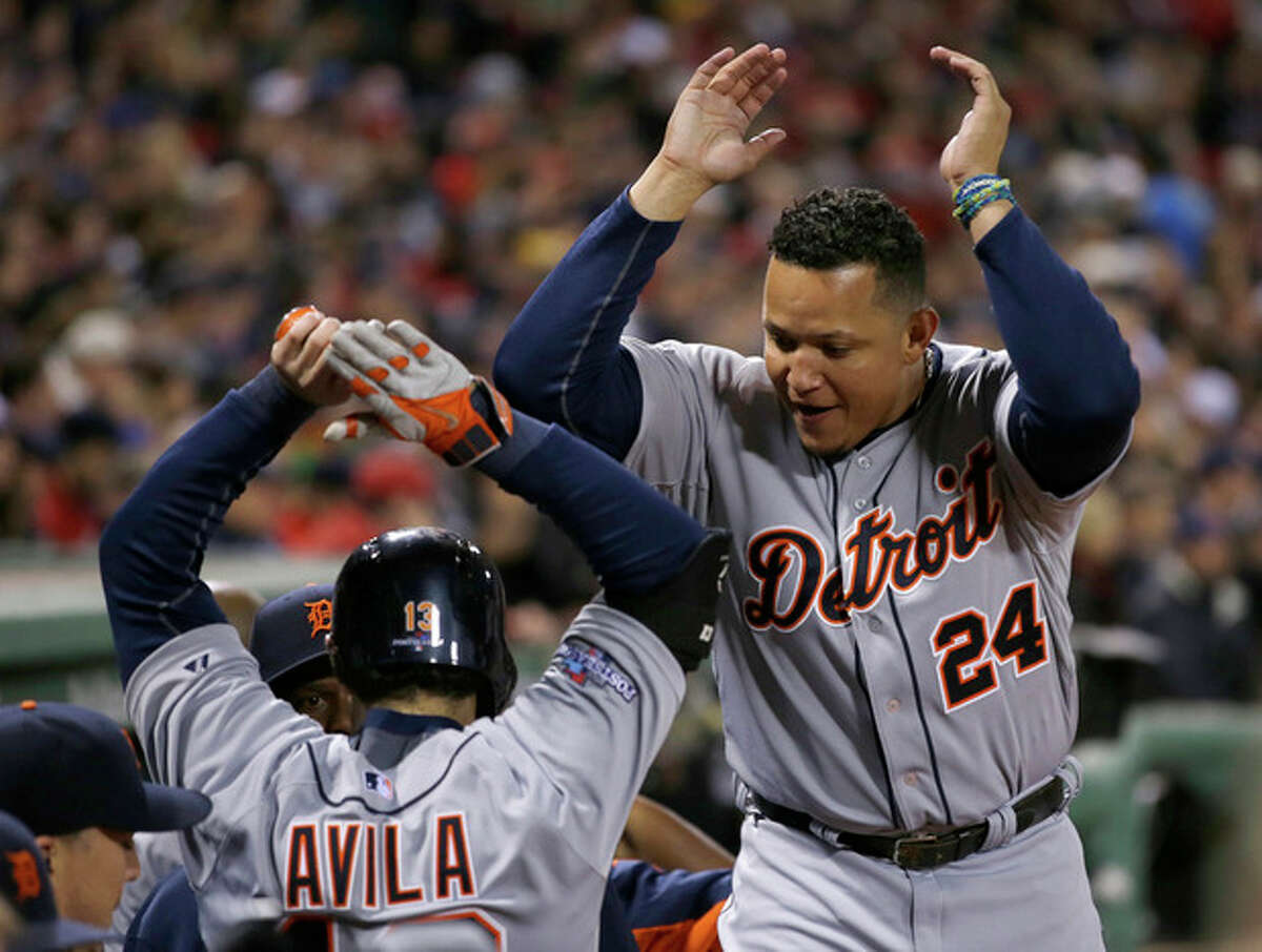 Detroit Tigers' Miguel Cabrera celebrates with Alex Avila after Avila his a two-run home run in the sixth inning during Game 2 of the American League baseball championship series against the Boston Red Sox Sunday, Oct. 13, 2013, in Boston. (AP Photo/Matt Slocum)