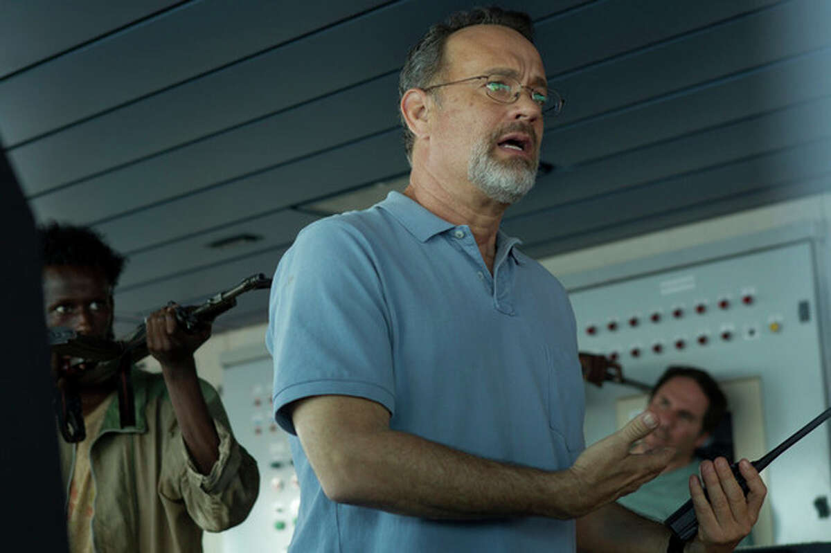 """This photo released by Sony - Columbia Pictures shows actor Tom Hanks in a scene from the film, """"Captain Phillips,"""" releasing in the US on Friday, Oct. 11, 2013. Some amateur actors from Minneapolis made their film debut acting alongside the two-time Academy Award winner, Hanks. The four actors of Somali descent appear as Somali pirates in ?""""Captain Phillips,?"""" which stars Hanks as the captain of a cargo ship hijacked off the Horn of Africa in 2009. (AP Photo/Copyright Sony - Columbia Pictures, Hopper Stone, SMPSP)"""