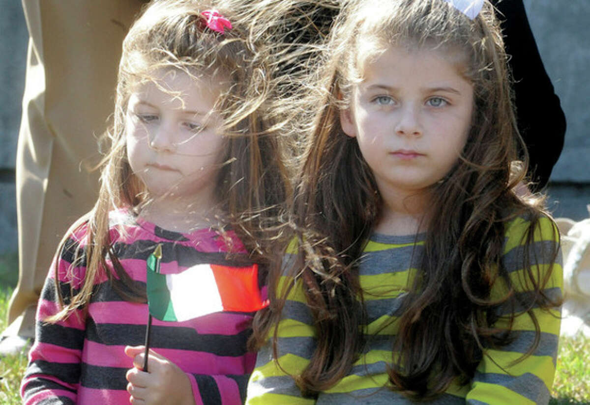 Alexa Lacomis 5 and her sister Audra 3, Sunday at the Italian American Day celebration held at Norwalk's Heritage Wall. Hour photo/Matthew Vinci