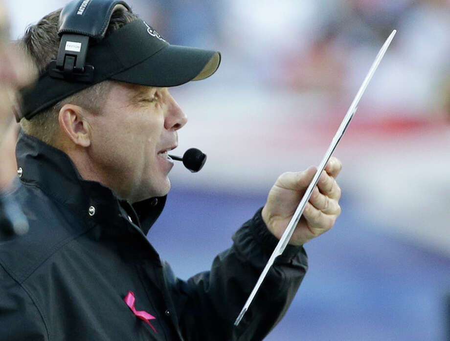 New Orleans Saints head coach Sean Payton checks his play card in the first half of an NFL football game against the New England Patriots Sunday, Oct.13, 2013, in Foxborough, Mass. (AP Photo/Stephan Savoia) / AP