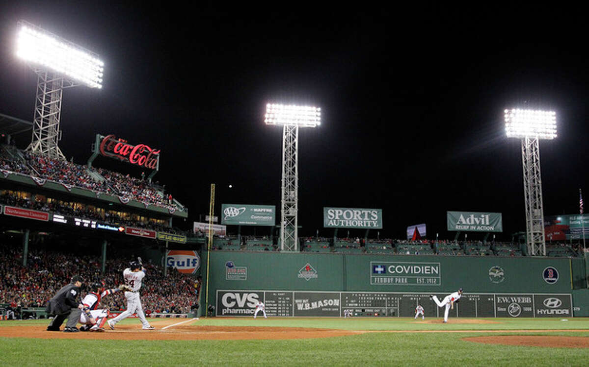 Detroit Tigers' Miguel Cabrera hits a home run in the sixth inning during Game 2 of the American League baseball championship series against the Boston Red Sox Sunday, Oct. 13, 2013, in Boston. (AP Photo/Charles Krupa)
