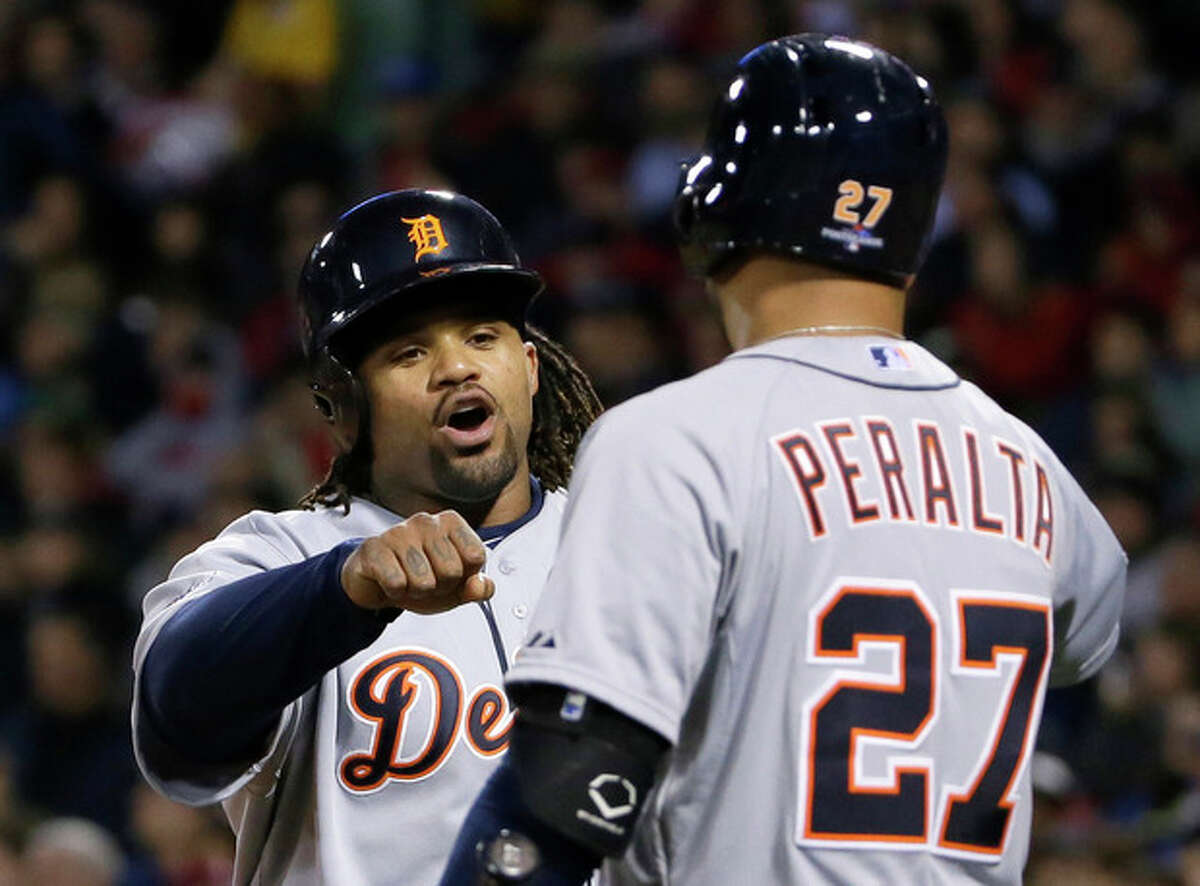 Detroit Tigers' Prince Fielder celebrates with Jhonny Peralta after scoring a run in the sixth during Game 2 of the American League baseball championship series against the Boston Red Sox Sunday, Oct. 13, 2013, in Boston. (AP Photo/Matt Slocum)