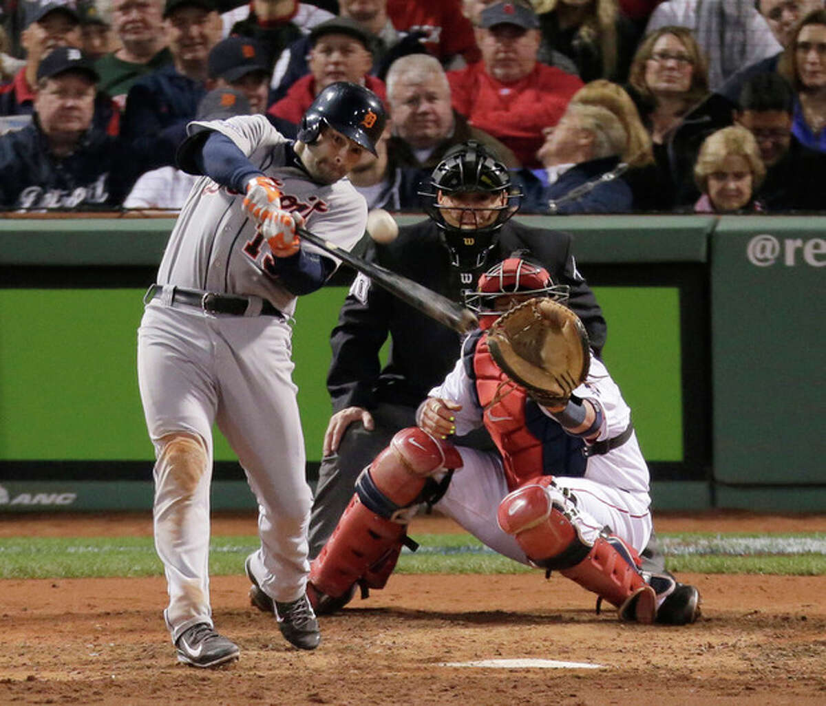 Detroit Tigers' Alex Avila hits a two-run home run during Game 2 of the American League baseball championship series against the Boston Red Sox Sunday, Oct. 13, 2013, in Boston. (AP Photo/Charlie Riedel)