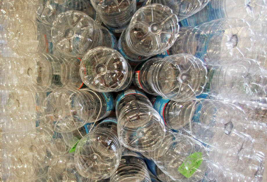 FILE - This Wednesday, Dec. 5, 2012 file photo shows a sculpture made of empty water bottles in Burlington, Vt. New research presented by the American Society for Reproductive Medicine on Monday, Oct. 14, 2013 suggests that high levels of BPA, a chemical in many plastics and canned food linings, might raise the risk of miscarriage in women prone to that problem or having trouble getting pregnant. (AP Photo/Toby Talbot, File) / AP