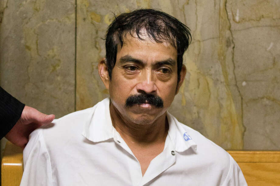 Conrado Juarez, cousin and confessed killer of 4-year-old Anjelica Castillo, nicknamed Baby Hope, waits to be arraigned at Manhattan Criminal Court, Saturday, Oct. 12, 2013, in New York. During an interrogation early Saturday, Juarez admitted sexually assaulting and smothering her before disposing her body. (AP Photo/John Minchillo) / FR170537 AP