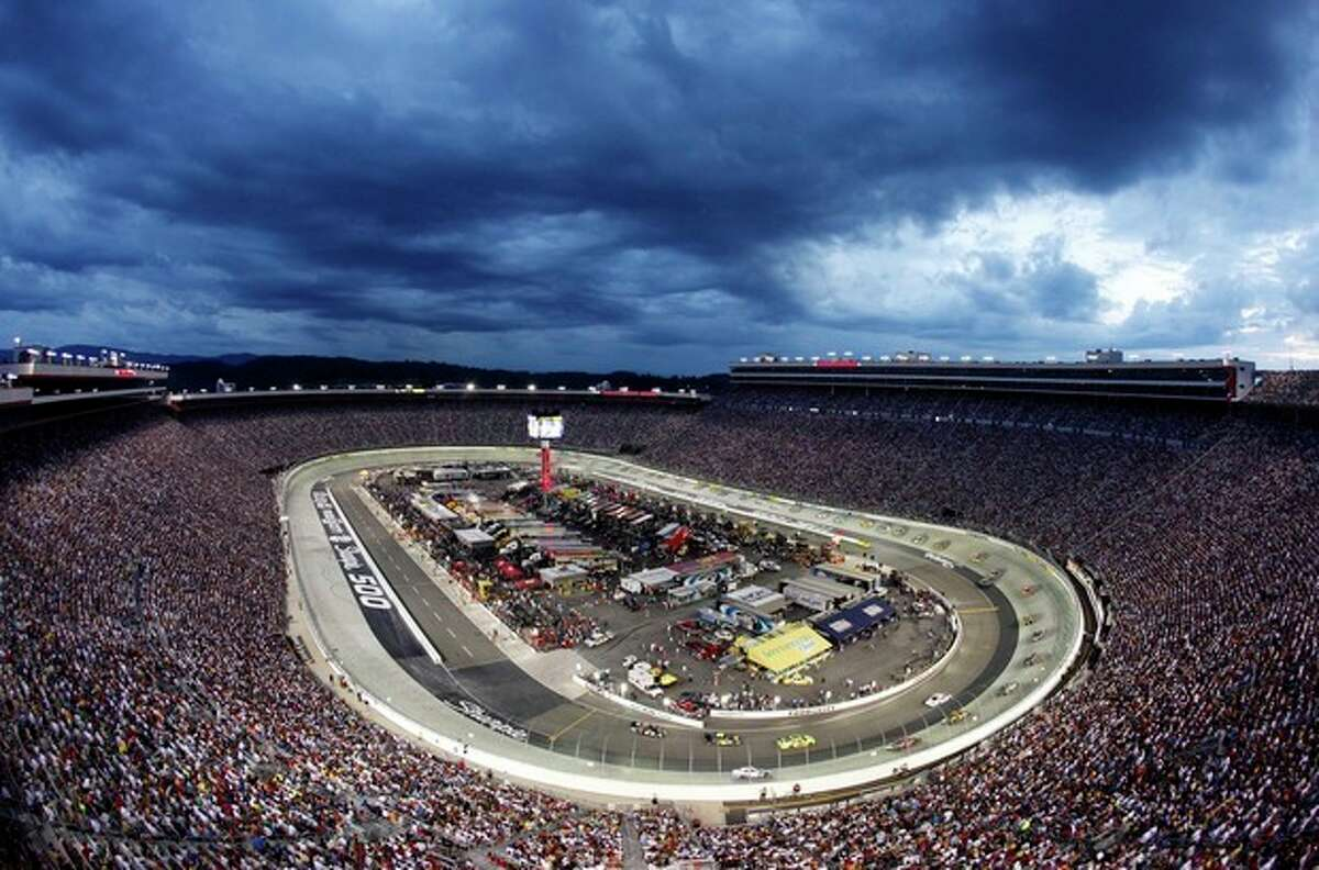 FILE - In this Aug. 22, 2009, file photo, the NASCAR Sprint Cup Series Sharpie 500 auto race is run under the lights at Bristol Motor Speedway in Bristol, Tenn. Bristol Motor Speedway is set to unveil its plan to host a football game between Tennessee and Virginia Tech in 2016. The announcement is planned for later Monday morning, Oct. 14, 2013, at the 52-year-old racetrack that sits nearly halfway between the campuses of the two schools, off Interstate 81 in Tennessee. The speedway can hold around 160,000, and organizers are hoping to break the NCAA-recognized attendance record for college football of 115,109, set last month at Michigan Stadium for Michigan-Notre Dame. (AP Photo/Mark Humphrey, File)