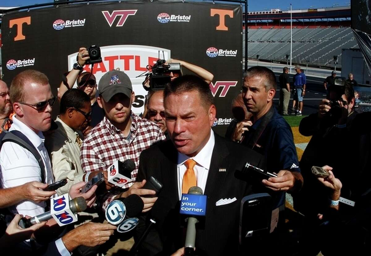 Tennessee head football coach Butch Jones speaks with reporters after a press conference at Bristol Motor Speedway in Bristol, Tenn. Tennessee and Virginia Tech will finally play a football game at Bristol Motor Speedway in what is being billed as the