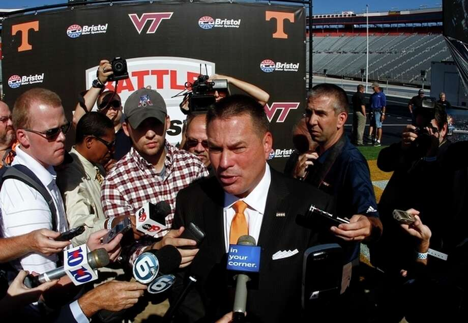 """Tennessee head football coach Butch Jones speaks with reporters after a press conference at Bristol Motor Speedway in Bristol, Tenn. Tennessee and Virginia Tech will finally play a football game at Bristol Motor Speedway in what is being billed as the """"Battle of Bristol."""" (AP Photo/Wade Payne) / FR23601 AP"""