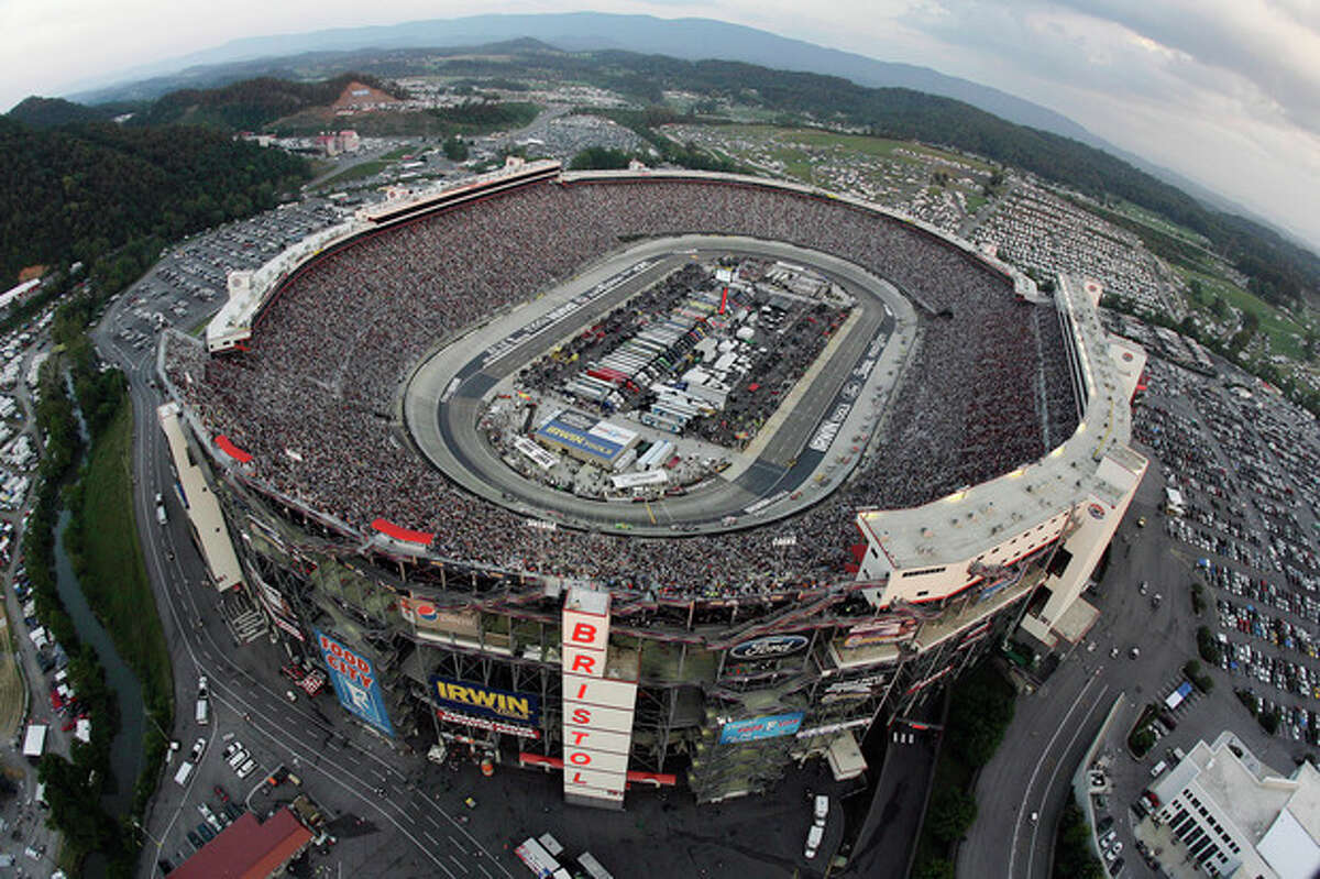 FILE - In this Aug. 25, 2012, file photo, the NASCAR Sprint Cup Series auto race is run at Bristol Motor Speedway in Bristol, Tenn. Bristol Motor Speedway is set to unveil its plan to host a football game between Tennessee and Virginia Tech in 2016. The announcement is planned for later Monday morning, Oct. 14, 2013, at the 52-year-old racetrack that sits nearly halfway between the campuses of the two schools, off Interstate 81 in Tennessee. The speedway can hold around 160,000, and organizers are hoping to break the NCAA-recognized attendance record for college football of 115,109, set last month at Michigan Stadium for Michigan-Notre Dame. (AP Photo/CIA Bristol Motor Speedway, Andrew Coppley, Pool, File)