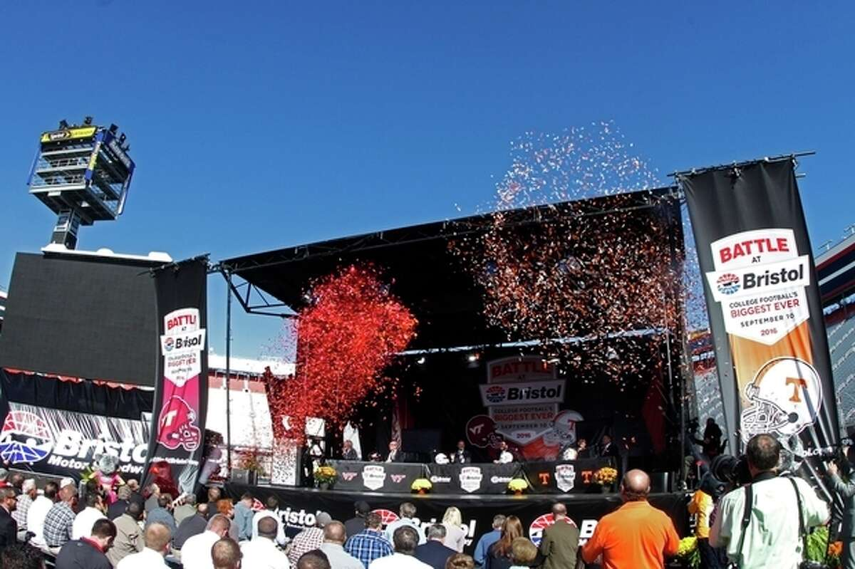 Confetti is fired into the sky during a press conference at Bristol Motor Speedway Monday, Oct. 14, 2013, in Bristol, Tenn., where it was announced that Tennessee and Virginia Tech will play a football game at the speedway in 2016. (AP Photo/Wade Payne)