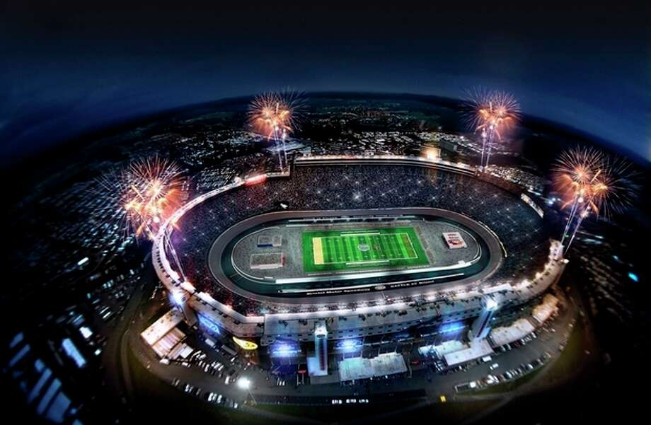 """This artist rendering provided by Bristol Motor Speedway, shows how the speedway is expected to look during a college football game in 2016. Tennessee and Virginia Tech will finally play a football game at Bristol Motor Speedway, in Bristol, Tenn., in what is being billed as the """"Battle of Bristol."""" (AP Photo/Bristol Motor Speedway) / BRISTOL MOTOR SPEEDWAY"""