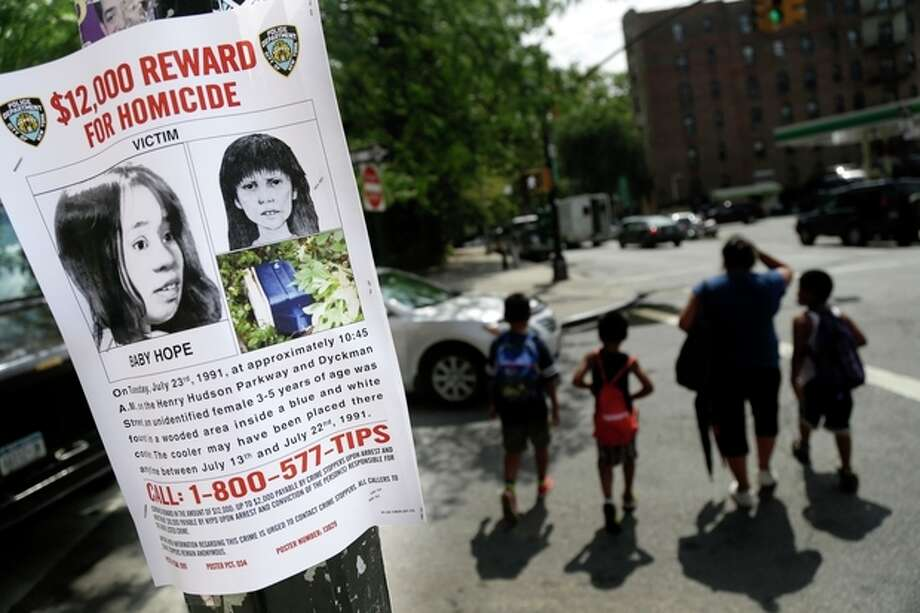 FILE - In this July 23, 2013, file photo shows a poster soliciting information regarding an unidentified body near the site where the body was found in New York. Police in New York City said Saturday, Oct. 12, 2013, that they had arrested the killer of a child who was nicknamed Baby Hope by detectives after her body was discovered inside a picnic cooler beside a Manhattan highway in 1991.(AP Photo/Seth Wenig, File) / AP