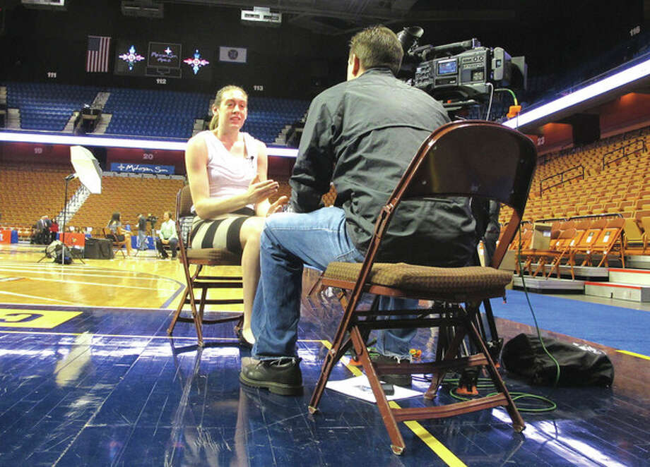 AP photoUConn's Breanna Stewart, the American Athletic Conference women's basketball preseason player of the year, does an interview during Monday's conference media day at Mohegan Sun Arena. / AP