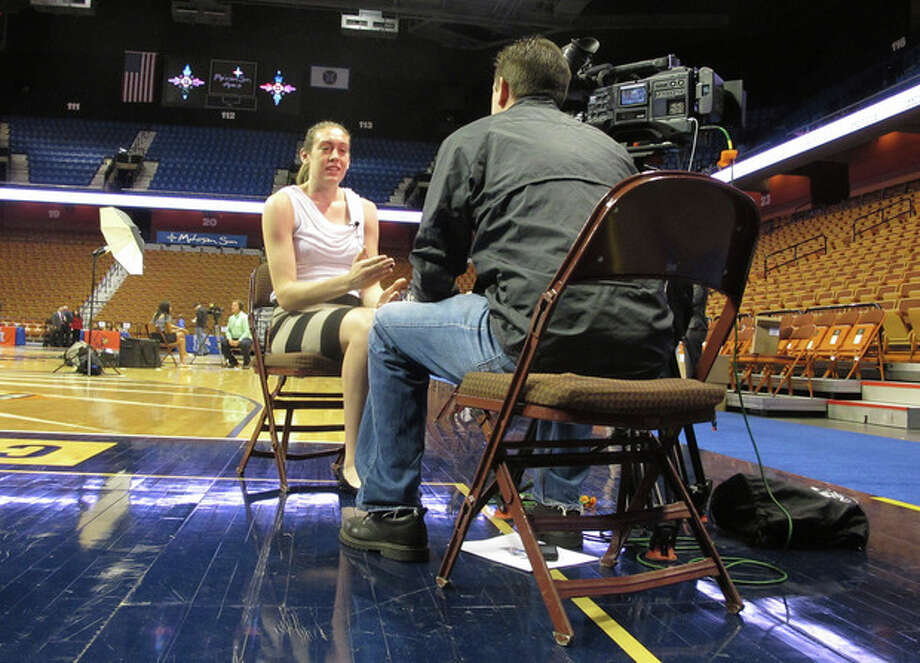 American Athletic Conference women's basketball preseason player of the year Brianna Stewart talks to a television reporter during the conference's inaugural women's basketball media day on Monday, Oct. 14, 2013 at the Mohegan Sun Arena in Uncasville, Conn. (AP Photo/Pat Eaton-Robb) / AP