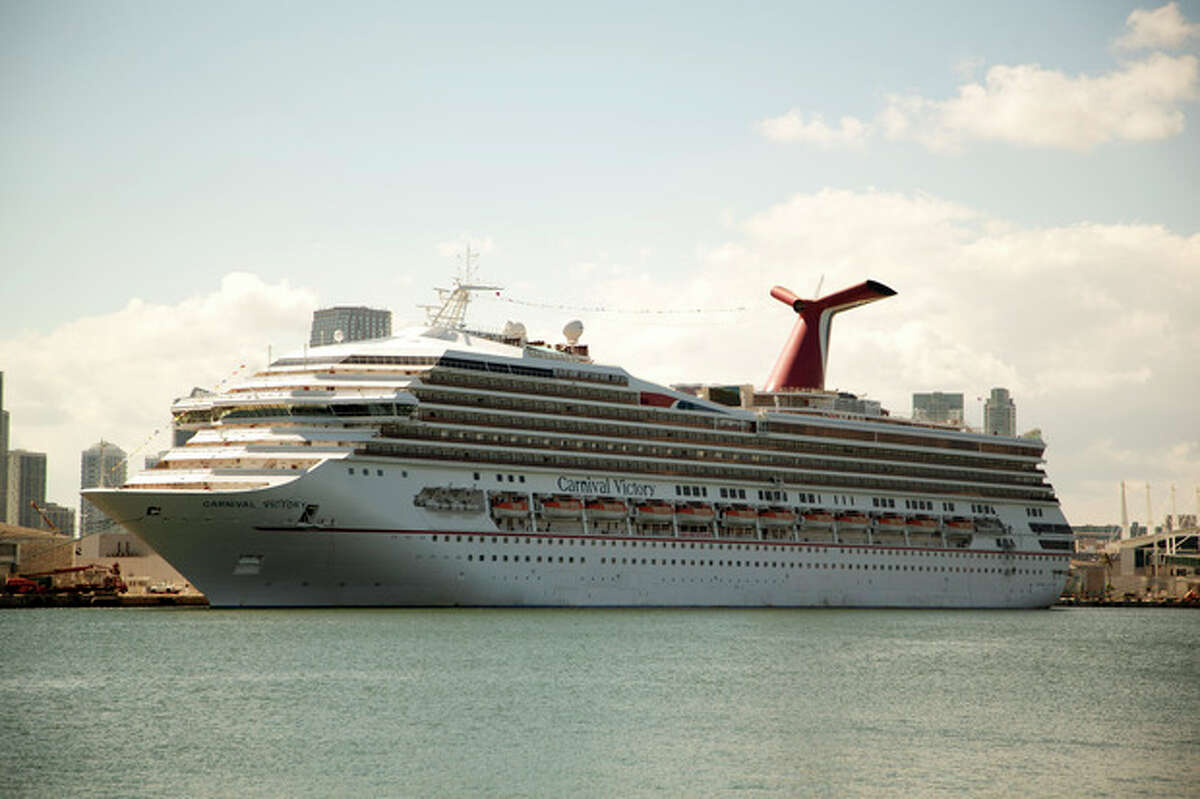 The Carnival Cruise line ship, Victory, sits in port in Miami, Monday, Oct. 14, 2013. A 6-year-old boy drowned on a Carnival Cruise ship, according to Miami-Dade police. The boy, Qwentyn Hunter of Winter Garden, Fla. was in the pool with his 10-year-old brother when he went under water and didn?'t surface. Other passengers pulled the boy from the water and tried to revive him, according to police. (AP Photo/J Pat Carter)