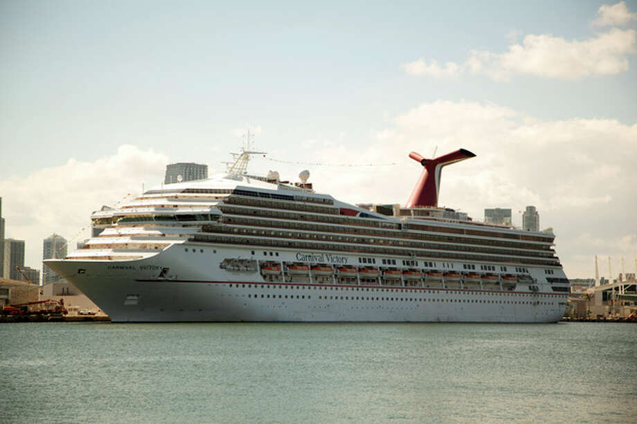 The Carnival Cruise line ship, Victory, sits in port in Miami, Monday, Oct. 14, 2013. A 6-year-old boy drowned on a Carnival Cruise ship, according to Miami-Dade police. The boy, Qwentyn Hunter of Winter Garden, Fla. was in the pool with his 10-year-old brother when he went under water and didn't surface. Other passengers pulled the boy from the water and tried to revive him, according to police. (AP Photo/J Pat Carter) / AP