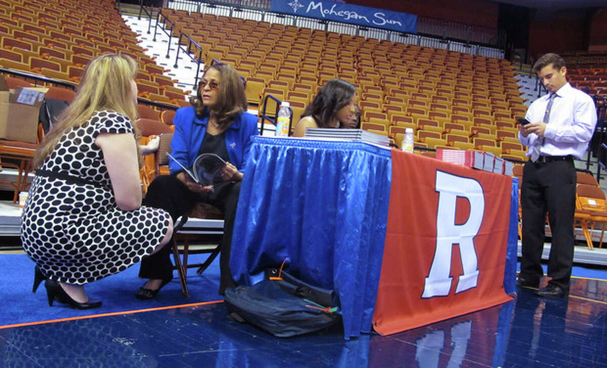 Rutgers women's basketball coach C. Vivian Stringer, center, talks with team spokeswoman Kim Zivkovich, left, while waiting with guard Betnijah Laney to do interviews at the American Athletic Conference's inaugural women's basketball media day at the Mohegan Sun Arena in Uncasville, Conn. on Monday, Oct. 14, 2013. (AP Photo/Pat Eaton-Robb)