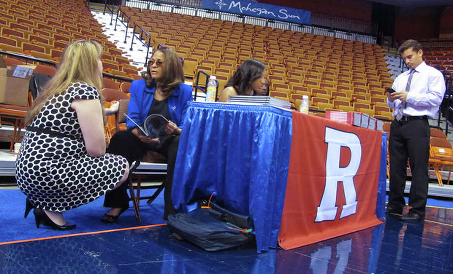 Rutgers women's basketball coach C. Vivian Stringer, center, talks with team spokeswoman Kim Zivkovich, left, while waiting with guard Betnijah Laney to do interviews at the American Athletic Conference's inaugural women's basketball media day at the Mohegan Sun Arena in Uncasville, Conn. on Monday, Oct. 14, 2013. (AP Photo/Pat Eaton-Robb) / AP{