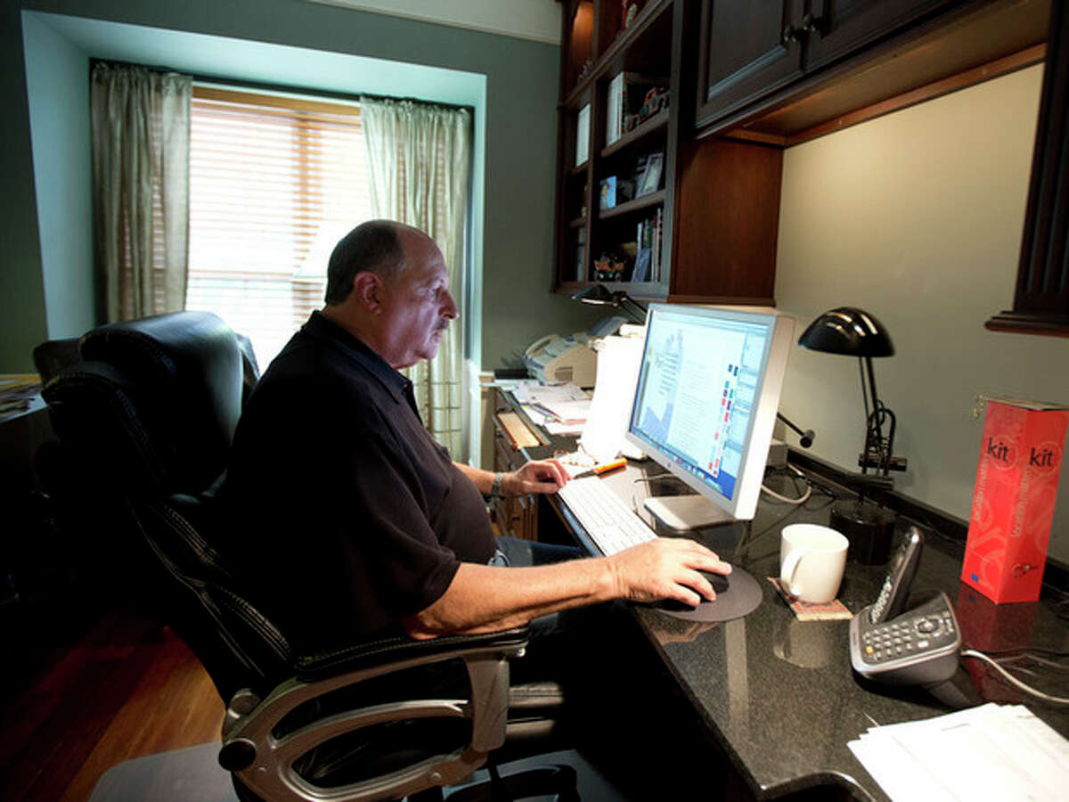 AP photo / Manuel Balce Ceneta In this Oct. 9 photo, graphic designer Tom Sadowski, 65, who delayed his retirement, works from home in Sterling, Va. Older Americans appear to have accepted the reality of a retirement that comes later in life and no longer represents a complete exit from the workforce.