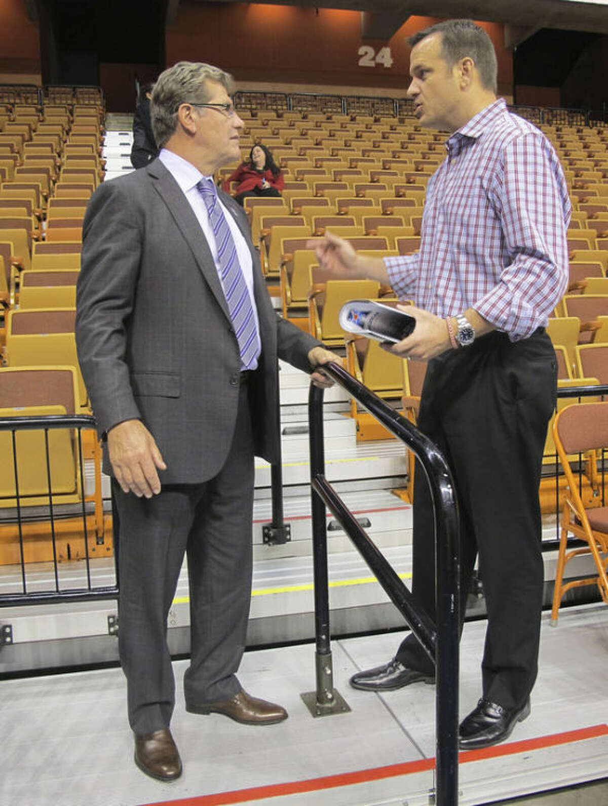 Connecticut women's basketball coach Geno Auriemma, left, and Louisville women's basketball coach Jeff Walz talk during the inaugural women's basketball media day for the American Athletic Conference on Monday Oct. 14, 2014 at the Mohegan Sun Arena in Uncasville, Conn. (AP Photo/Pat Eaton-Robb)