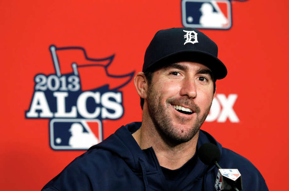 Detroit Tigers pitcher Justin Verlander smiles during a media availability at Comerica Park before practice for Game 3 of the American League baseball championship series against the Boston Red Sox in Detroit, Monday, Oct. 14, 2013. (AP Photo/Paul Sancya) / AP