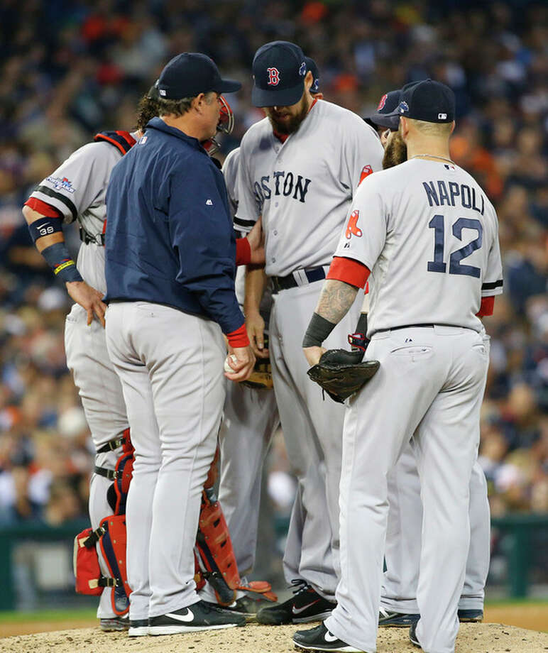 Boston Red Sox manager John Farrell takes out John Lackey in the seventh inning during Game 3 of the American League baseball championship series against the Detroit Tigers Tuesday, Oct. 15, 2013, in Detroit. (AP Photo/Paul Sancya) / AP
