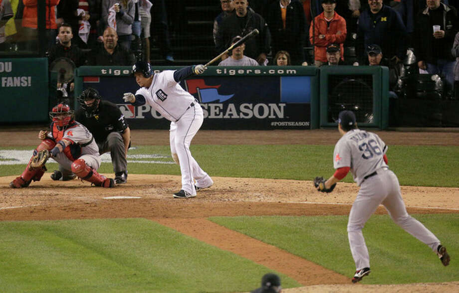 Detroit Tigers' Miguel Cabrera strikes out in the eighth inning against Boston Red Sox relief pitcher Junichi Tazawa during Game 3 of the American League baseball championship series Tuesday, Oct. 15, 2013, in Detroit. (AP Photo/Charlie Riedel) / AP