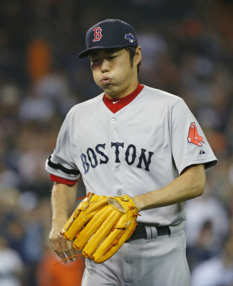 Boston Red Sox relief pitcher Koji Uehara reacts after striking out Detroit Tigers' Prince Fielder to end the eighth inning during Game 3 of the American League baseball championship series Tuesday, Oct. 15, 2013, in Detroit. (AP Photo/Paul Sancya)