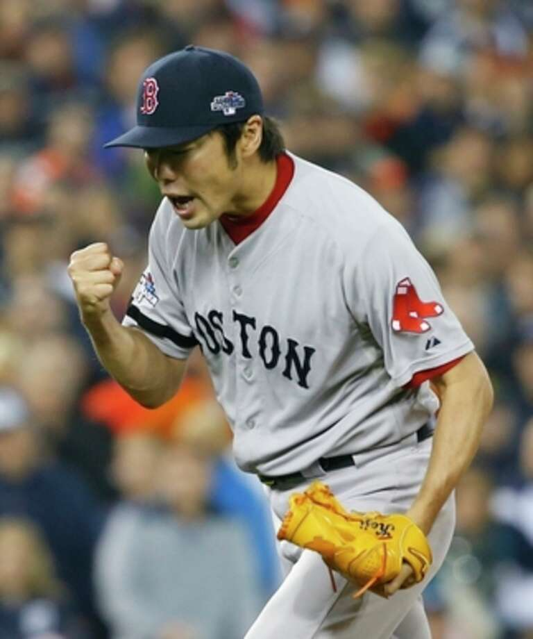 Boston Red Sox's Koji Uehara celebrates after the Red Sox defeated the Detroit Tigers 1-0 in Game 3 of the American League baseball championship series Tuesday, Oct. 15, 2013, in Detroit. (AP Photo/Paul Sancya) / AP
