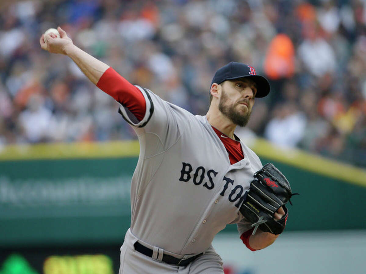 Boston Red Sox starting pitcher John Lackey throws in the first inning during Game 3 of the American League baseball championship series against the Detroit Tigers Tuesday, Oct. 15, 2013, in Detroit. (AP Photo/Matt Slocum)