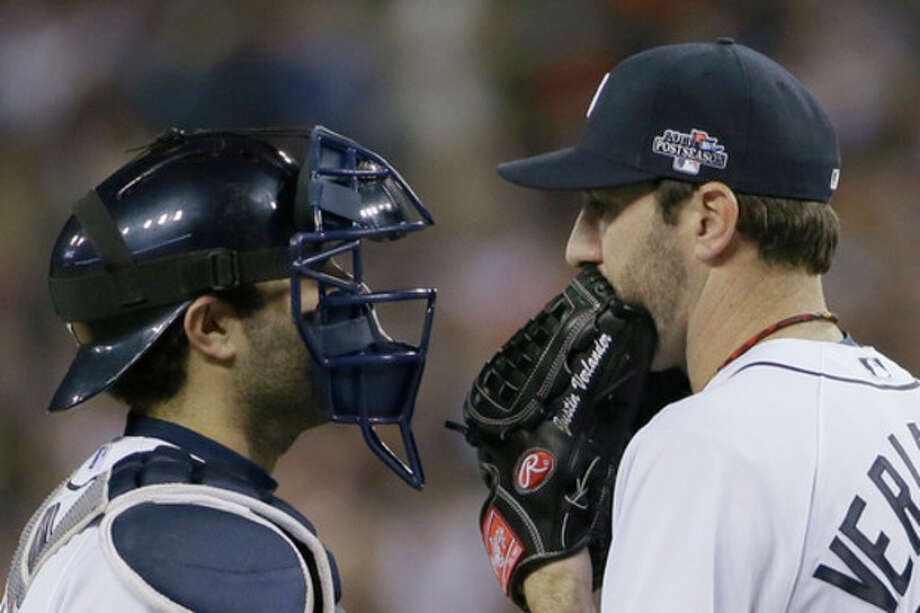 Detroit Tigers starting pitcher Justin Verlander talks with catcher Alex Avila in the eighth inning during Game 3 of the American League baseball championship series against the Boston Red Sox Tuesday, Oct. 15, 2013, in Detroit. (AP Photo/Matt Slocum) / AP