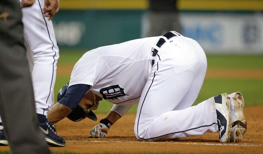 Detroit Tigers' Victor Martinez goes to the ground following a single in the ninth inning during Game 3 of the American League baseball championship series against the Boston Red Sox Tuesday, Oct. 15, 2013, in Detroit. (AP Photo/Paul Sancya) / AP