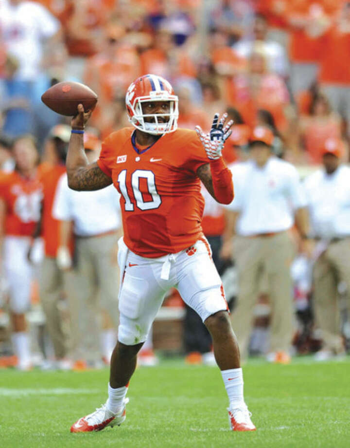 Clemson quarterback Tajh Boyd throws a pass during the first half of an NCAA college football game Saturday against Boston College, Oct. 12, 2013, at Memorial Stadium in Clemson, S.C. Clemson won 24-14. (AP Photo/ Richard Shiro)