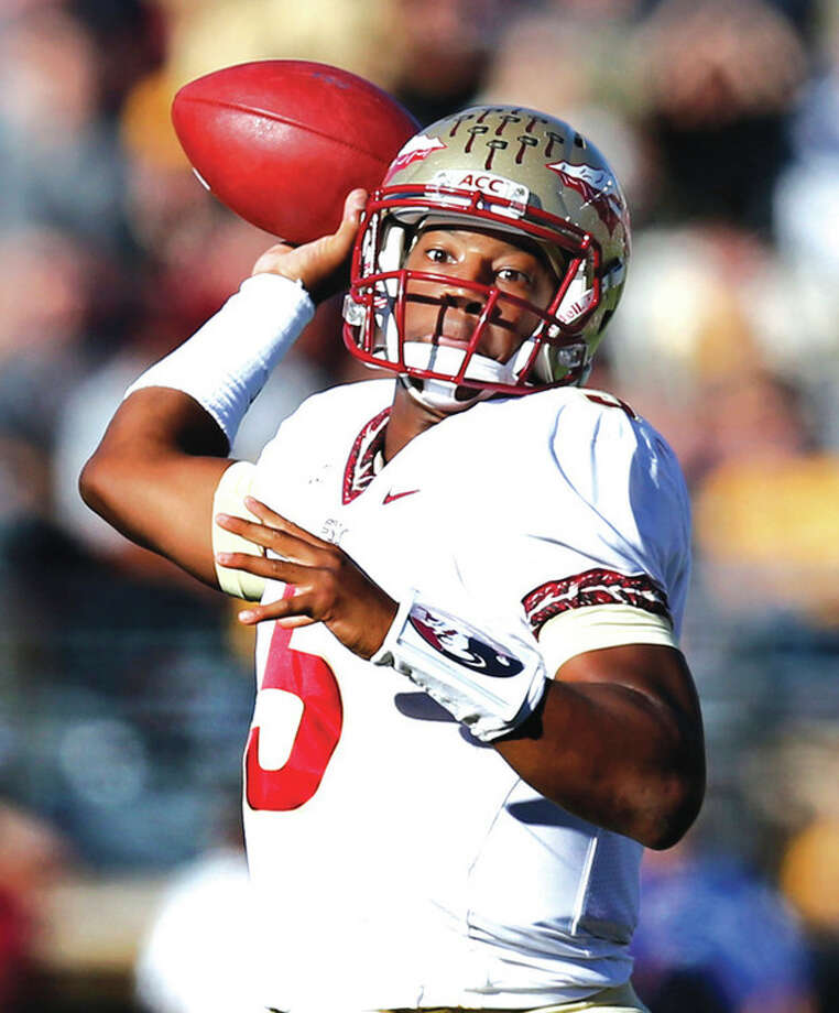 File- This Sept. 28, 2013 file photo shows Florida State quarterback Jameis Winston (5) passing the ball during the first quarter of an NCAA college football game against Boston College at Alumni Stadium in Boston. There's not an enormous difference between Winston and Tajh Boyd of Clemson. At least not to a couple of former NFL executives. Gil Brandt, former Dallas Cowboys vice president of player personnel, says the redshirt freshman Winston has a slightly stronger arm. (AP Photo/Elise Amendola, File) / AP