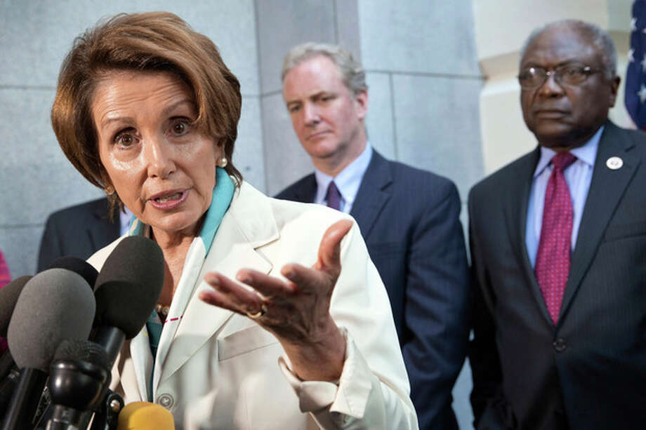 House Minority Leader Nancy Pelosi, D-Calif., speaks with reporters before going to the White House to meet with President Barack Obama, at the Capitol in Washington, Tuesday, Oct. 15, 2013, as Rep. Chris Van Hollen, D-Md., and Assistant Minority Leader James Clyburn, D-S.C., right, listen. (AP Photo/J. Scott Applewhite) / AP