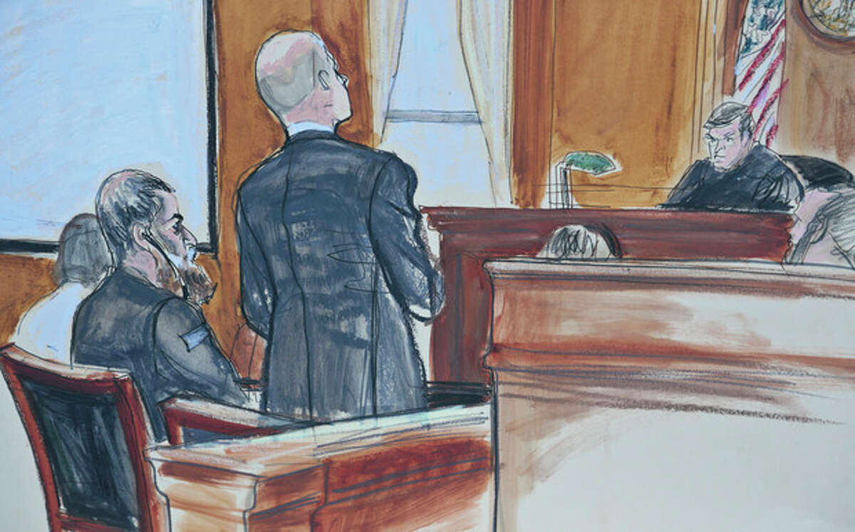 In this courtroom sketch, Abu Anas al-Libi, 49, second from left, sits as his lawyer David Patton, second from right, address Judge Lewis Kaplan, far right, in a federal courtroom in New York, Tuesday, Oct. 15, 2013. Abu Anas al-Libi, a Libyan, pleaded not guilty to terrorism charges in the deadly 1998 al-Qaida bombings of U.S. embassies in Africa. (AP Photo/Elizabeth Williams)