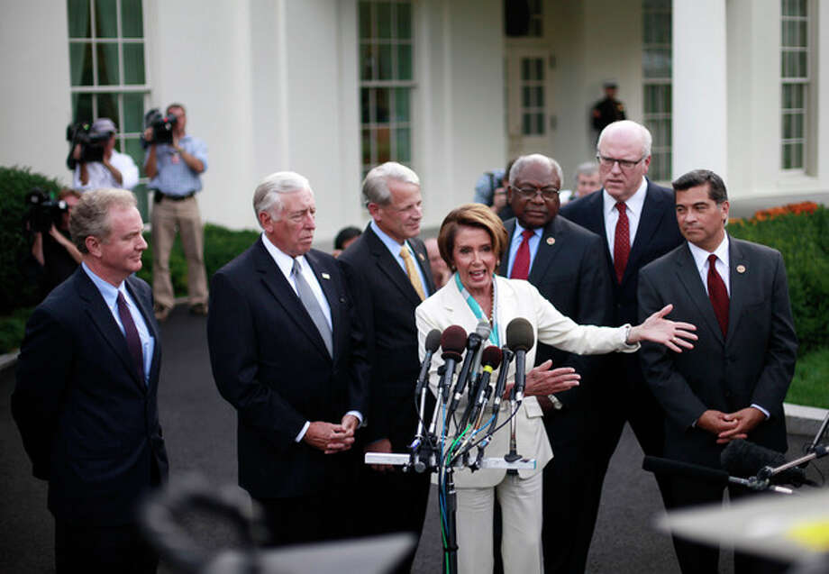 From left to right, Rep. Chris Van Hollen, D-Md., Rep. Steny Hoyer, D-Md., Rep. Steve Israel, D-N.Y., House Minority Leader Nancy Pelosi of Calif., Rep. James Clyburn, D-S.C., Rep. Joseph Crowley, D-N.Y., and Rep. Xavier Becerra, D-Calif., speaking with members of the media outside the West Wing of the White House following their meeting with President Barack Obama and Vice President Joe Biden, Tuesday, Oct. 15, 2013, in Washington. The partial government shutdown is in its third week and less than two days before the Treasury Department says it will be unable to borrow and will rely on a cash cushion to pay the country's bills. (AP Photo/Pablo Martinez Monsivais) / AP