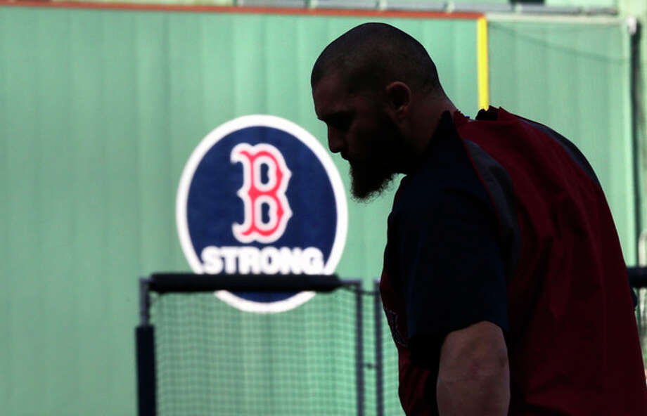 Boston Red Sox's Jonny Gomes heads to home plate to take batting practice during a team workout at Fenway Park, Friday, Oct. 18, 2013, in Boston. The Red Sox will face the Detroit Tigers in Game 6 of the American League baseball championship series on Saturday. (AP Photo/Charles Krupa) / AP