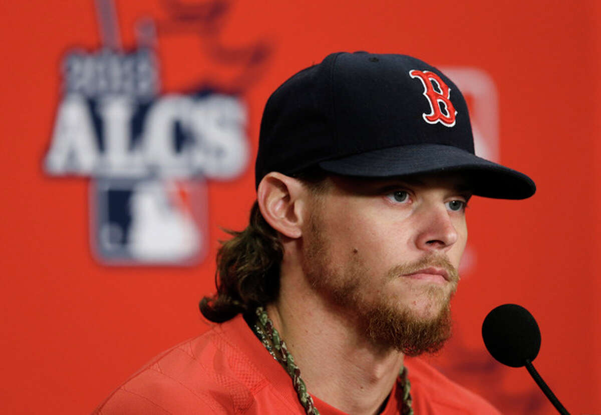 Boston Red Sox starting pitcher Clay Buchholz listens to a question before the start of Game 5 of the American League baseball championship series against the Detroit Tigers Thursday, Oct. 17, 2013, in Detroit. Buchholz is expected to start Game 6 for Boston on Saturday in Boston. (AP Photo/Carlos Osorio)