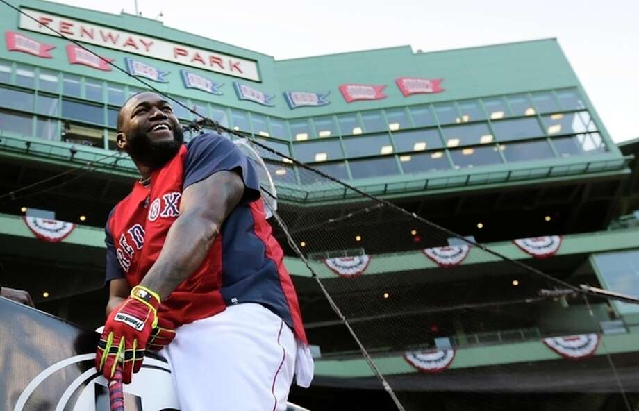 Boston Red Sox designated hitter David Ortiz laughs as he takes a break from hitting during a baseball workout at Fenway Park, Friday, Oct. 18, 2013, in Boston. The Red Sox are scheduled to host the Detroit Tigers in Game 6 of the American League baseball championship series on Saturday. (AP Photo/Charles Krupa) / AP