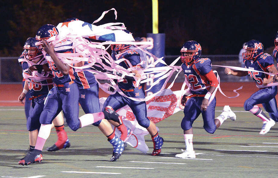 The Senators hit the field, photo at right, through streamers held by the cheerleaders for their Homecoming game against Stamford Friday night at Casagrande Field