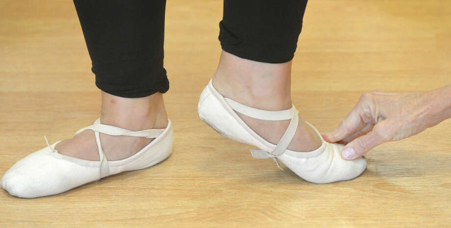 Hour Photo/Alex von Kleydorff . Just the right position for the feet in a class at Freyer Academy of Ballet in Wilton.